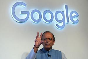 India's finance minister Arun Jaitley at the launch of the Google Tez mobile app for digital payments in New Delhi on Sept 18, 2017.