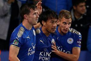 Leicester City's Shinji Okazaki celebrates scoring their first goal with Ben Chilwell (left) and Marc Albrighton.