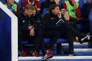 Liverpool manager Juergen Klopp (left) during the match.