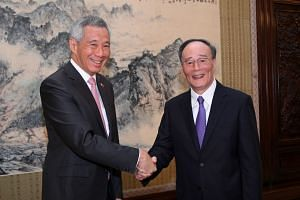 Prime Minister Lee Hsien Loong meets China's Secretary of the Central Commission for Discipline Inspection Wang Qishan at Zhongnanhai, in Beijing, on Wednesday, Sept 20, 2017.