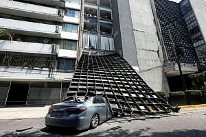 A damaged car is seen outside a building after an earthquake in Mexico City, on Sept 19, 2017.