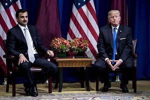 Qatar's Emir Tamim bin Hamad al-Thani and US President Donald Trump meet at the Palace Hotel on Sept 19, 2017 in New York City.