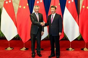 Prime Minister Lee Hsien Loong on Wednesday (Sept 20) met Chinese President Xi Jinping (right) at Beijing's Great Hall of the People.