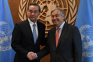 United Nations Secretary General Antonio Guterres (right) met with Mr Wang Yi, China's Minister for Foreign Affairs, on Sept 18, 2017, at the United Nations in New York.
