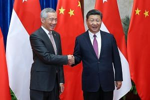 Prime Minister Lee Hsien Loong with Chinese President Xi Jinping before a meeting at the Great Hall of the People in Beijing yesterday. Both leaders agreed to continue working closely together to promote even stronger Asean-China ties.