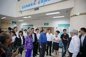 PM Lee Hsien Loong and the Singapore delegation visiting the Fujian (Xiamen) - Singapore Friendship Polyclinic.