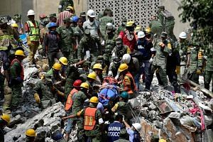 A man pulled out of the rubble alive in Mexico City on Wednesday, a day after a 7.1-magnitude earthquake rocked central Mexico.