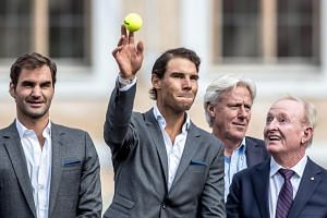 (from left) Swiss tennis player Roger Federer, Spanish Rafael Nadal, captain of Team Europe Bjoern Borg and former Australian tennis player Rod Laver attend the welcome parade of the Laver Cup tennis tournament at the Old Town Square in Prague, Czech