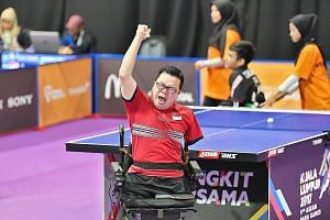Jason Chee celebrating yesterday after beating Thailand's Thirayu Chueawong in the last match in a round-robin tournament to clinch his first individual gold medal at the Asean Para Games.