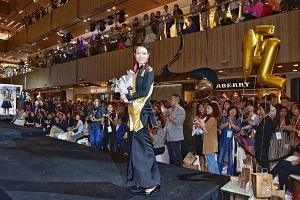 Ms Jean Yong, The New Paper New Face 2017 winner, taking her victory walk at Paragon mall yesterday evening.