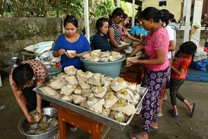 Villagers prepare food at an evacuation centre in Karangasem on the Indonesian resort island of Bali on Sept 24, 2017.