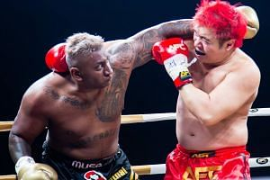 Pradip Subramanian (left) fighting Steven Lim during the Asia Fighting Championship (AFC) match at Marina Bay Sands.