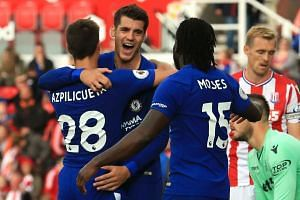Morata (second left) celebrates with team mates after scoring their fourth goal, his third.