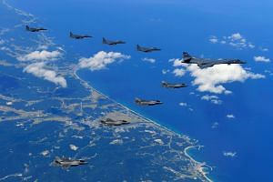 A Sept 18, 2017, photo shows a US Air Force B-1B Lancer bomber (right) and fighter jets flying over South Korea during a joint military drill.