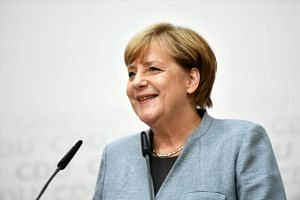 Germany Chancellor Angela Merkel made clear she still intended to serve a full four years as chancellor.