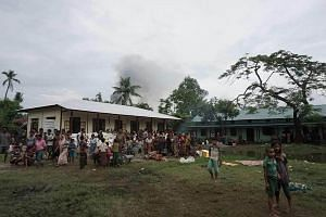 Myanmar Hindus gather at a makeshift camp in Maungdaw after fleeing violence in the area on Aug 30, 2017.