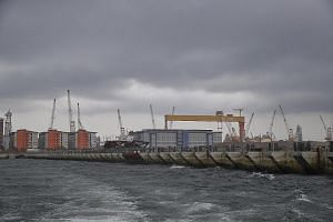 Above: Caissons are used to build the wharf structure. The 28m-high concrete watertight structures are each about the height of a 10-storey Housing Board block. Left: Two completed caissons, one of which is in the floating dock (far left), awaiting t