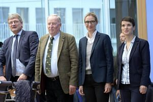 Alternative for Germany's (from left) Joerg Meuthen, Alexander Gauland,  Alice Weidel and  Frauke Petry prior to news conference in Berlin on Sept 25, 2017.