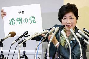 Tokyo Governor Yuriko Koike announcing the name of the new national political party, Kibo No To (Party Of Hope), in Tokyo yesterday, ahead of snap polls expected next month. Her direct involvement in the party came as a surprise, as she was previousl