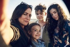 Pamela Adlon's character in Better Things has to juggle a demanding mother, a distant ex-husband and three headstrong daughters, played by (from far left) Olivia Edward, Hannah Alligood and Mikey Madison.