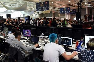 Video-game players at the eSports World Convention in Bordeaux last July. The global eSports industry is forecast to reach US$1.1 billion (S$1.5 billion) by the end of this year, with Asia the biggest region, accounting for more than US$328 million i