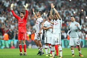 Besiktas' goalkeeper Fabri (left), Pepe (second left) and their teammates celebrate with fans after the UEFA Champions League in Istanbul, Turkey, on Sept 26, 2017.