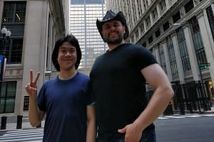 Amos Yee poses for a photo with Adam Lowisz, who has been helping Yee with his application for asylum. Yee said in a Facebook post that he is now a free man.