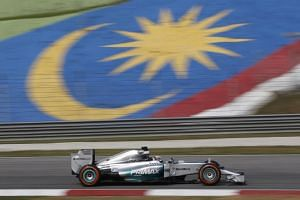 Mercedes Formula One driver Hamilton of Britain drives during the first practice session of the Malaysian F1 Grand Prix at Sepang International Circuit.