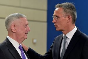 US Secretary of Defence Mattis chats with Nato Secretary General Stoltenberg during a Nato defence ministers meeting in Brussels.