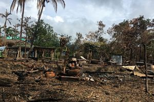 A burnt house is seen in a village near Maungdaw, in the north of Rakhine state, Myanmar on Sept 12, 2017.