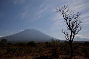 More than 120,000 people have now fled Mount Agung in fear of a possible eruption, packing into temporary shelters or moving in with relatives.