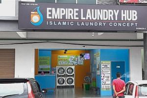 The green sign inside the launderette in Kangar, Perlis, states that its service is for Muslims only.