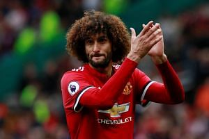 Manchester United's Marouane Fellaini applauds fans after the match.