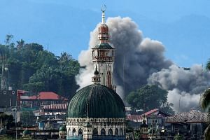 The conflict in Marawi (left) began in May. Despite losing ground to the Philippine armed forces, militants there have defied predictions and proven difficult to root out.