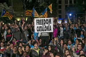 People celebrate in Catalunya's square after the Catalonia independence referendum in Barcelona on Oct 1, 2017.