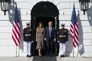 US President Donald Trump and First Lady Melania Trump prepare to hold a moment of silence for the victims of the mass shooting in Las Vegas on the South Portico of the White House.