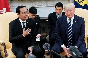 "Thai Prime Minister Prayut Chan-o-cha with US President Donald Trump in the White House on Monday. Mr Prayut said he had a new friend in Mr Trump, and was ""deeply appreciative"" of being invited there."