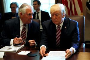 U.S. President Donald Trump talks with Secretary of State Rex Tillerson during a meeting with members of his Cabinet at the White House in Washington on June 12, 2017.