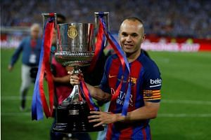 Barcelona's Andres Iniesta celebrating with the Spanish King's Cup in May 2017.