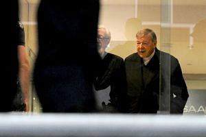 Cardinal George Pell (right) arrives for his committal hearing relating to charges of historical sex abuse at the Melbourne Magistrates Court on Oct 6, 2017.