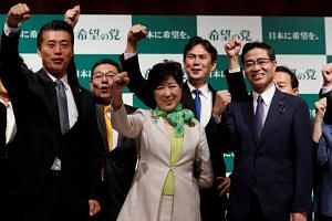 Tokyo Governor Yuriko Koike (centre), the leader of her new Party of Hope, with her party members at a news conference to announce the party's campaign platform in Tokyo, Japan, on Sept 27, 2017.