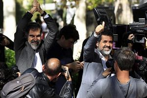 Mr Jordi Cuixart (far left) and Mr Jordi Sanchez, leaders of Catalonia's two biggest pro-independence civil groups, and regional police chief Josep Lluis Trapero (above) avoided being remanded in custody at a court hearing on Thursday over sedition a