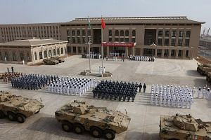 People's Liberation Army personnel at the opening ceremony of China's military base in Djibouti on Aug 1. The army announced the establishment of the logistics support base in July.