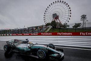 Mercedes driver Lewis Hamilton of Britain in action during the second practice session of the Japanese Grand Prix at the Suzuka Circuit yesterday. The championship leader will look to extend his 34-point cushion over arch-rival Sebastian Vettel of Fe