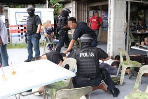 Officers from the Malaysian Special Branch Counter-Terrorism Division in an anti-terror raid in Sandakan, Sabah, last month that netted five suspected militants.