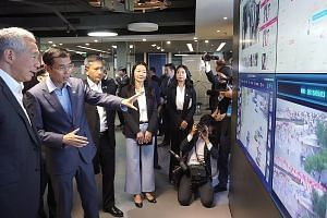 Prime Minister Lee Hsien Loong being given a tour of Chinese artificial intelligence company SenseTime when he visited Beijing last month.
