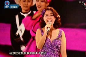 Singer Joanna Dong performing during the Sing! China final, on Oct 8, 2017.