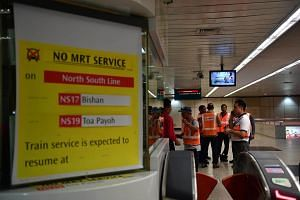 SMRT staff seen at Braddell MRT station on Oct 7, 2017. A sign was put up showing that there was no MRT service between Bishan and Toa Payoh.