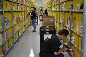 Amazon staff preparing orders at its Prime Now facility in Singapore. The South-east Asian e-commerce market is projected to reach US$88 billion (S$120 billion) by 2025, according to a report by Google and Temasek Holdings.
