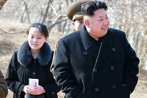 An undated photo released by the Korean Central News Agency in 2015 shows North Korean leader Kim Jong Un touring a military unit with his younger sister Kim Yo Jong.
